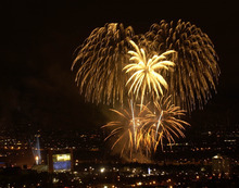 Al Hartmann | The Salt Lake Tribune file photo A massive fireworks display at the end of the Opening Ceremony dwarfs the newly lit cauldron at Rice Eccles Stadium, seen in the lower left.