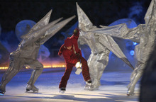 Rick Egan  |  The Salt Lake Tribune file photo  Costumed skaters perform during the Opening Ceremony at Rice-Eccles Stadium.