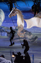Steve Griffin  |  The Salt Lake Tribune file photo Skaters carry replica horses during the Opening Ceremony at Rice-Eccles Stadium.