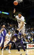 Colorado's Carlon Brown (30) throws up a shot  and is fouled by Washington's Aziz N