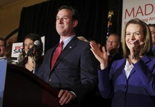 U.S Repbulican presidential candidate and former U.S. Senator Rick Santorum (L), with his wife Karen (R), speaks at his primary night rally at the St. Charles Convention Center in St. Charles, Missouri, February 7, 2012 after winning the Republican presidential caucuses in Minniesota and Missouri.  REUTERS/Sarah Conard (UNITED STATES  - Tags: POLITICS ELECTIONS)