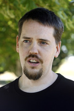 Rick Egan   |  Tribune file photo Joshua Powell talks in August 2011 in Puyallup, Wash., after hs father, Steve Powell, got arrested and charged with 14 counts of voyeurism and possession of depictions of minors engaged in sexually explicit conduct.