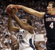 Kim Raff |The Salt Lake Tribune BYU player Elias Harris goes for a basket as Gonzaga player Kevin Pangos defends during a game at the Marriott Center in Provo, Utah on February 2, 2012.