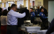 (AP Photo/Charles Dharapak) The Salt Lake City launch is part of TSA's plan to expand the  screening program to 28 more airports. There will be no cost to eligible passengers, who would no longer have to remove their shoes and belts before passing through security.