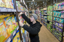 Al Hartmann     The Salt Lake Tribune Jessica Dempson, natural and specialty foods manager at Harmons City Creek store, prepares shelves for the Wednesday opening.