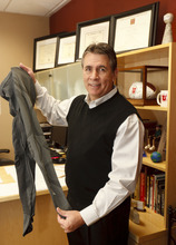 Trent Nelson  |  The Salt Lake Tribune Roger Petersen, the director of therapy at TOSH, displays a pair of compression tights at his office in Murray. An avid cyclist, Petersen suffers from chronic venous insufficiency, a condition in which the veins can't pump enough blood back to the heart. Once debilitated by the pain of blood pooling in his extremities, Petersen is now pain-free when he wears the tights during activities and recovery.