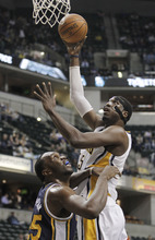 Indiana Pacers' Roy Hibbert shoots over Utah Jazz's Al Jefferson during the first half of an NBA basketball game Tuesday, Feb. 7, 2012, in Indianapolis. (AP Photo/Darron Cummings)