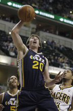 Utah Jazz's Gordon Hayward grabs a rebound from Indiana Pacers' Danny Granger during the first half of an NBA basketball game Tuesday, Feb. 7, 2012, in Indianapolis. (AP Photo/Darron Cummings)