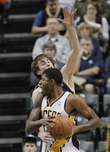 Indiana Pacers' Paul George, front, is fouled by Utah Jazz's Gordon Hayward during the second half of an NBA basketball game Tuesday, Feb. 7, 2012, in Indianapolis. Indiana won 104-99. (AP Photo/Darron Cummings)