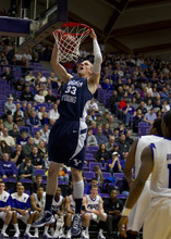 In this photo provided by the University of Portland, BYU's Nate Austin (33) dunks against Portland during the first half of their NCAA college basketball game in Portland, Ore., Saturday, Feb. 4, 2012. (AP Photo/University of Portland, Steven Gibbons)