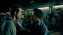 Ryan Reynolds, left, and Denzel Washington in