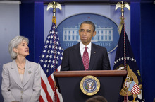 President Barack Obama, accompanied by Health and Human Services Secretary Kathleen Sebelius, announces the revamp of his contraception policy requiring religious institutions to fully pay for birth control, Friday, Feb. 10, 2012, in the Brady Press Briefing Room of the White House in Washington. (AP Photo/Susan Walsh)