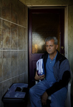 Sam Guzman, 61, holding two-years worth of correspondence with the bank at his front door in Westminster, California, on Thursday, February 9, 2012. Guzman has spent years fighting with Wells Fargo, tryng to avoid eviction on his now-foreclosed home. For homeowners like him, he said, the roughly $2,000 he would receive from Thursday's massive mortgage settlement is a little too late. (Francine Orr/Los Angeles Times/MCT)