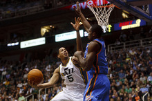 Trent Nelson  |  The Salt Lake Tribune Utah Jazz guard Devin Harris (5) scores two as the Utah Jazz host the Oklahoma City Thunder, NBA basketball at EnergySolutions Arena Friday, February 10, 2012 in Salt Lake City, Utah.