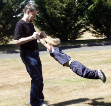 Rick Egan   |  The Salt Lake Tribune  Joshua Powell plays with his son Braden, in a park near his home, in Puyallup, Wash.,  Friday, Aug. 19, 2011.