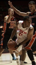 Kim Raff |The Salt Lake Tribune University of Utah player Chris Hines looks for a pass as he is defended by Oregon State players (left) Roberton Nelson and Jared Cunningham during the first half at the Huntsman Center in Salt Lake City, Utah on February 4, 2012.