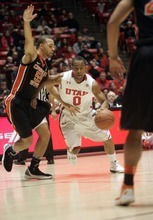 Kim Raff |The Salt Lake Tribune University of Utah player Chris Hines dribbles past Oregon State player Roberton Nelson during the first half at the Huntsman Center in Salt Lake City, Utah on February 4, 2012.