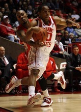 Trent Nelson  |  The Salt Lake Tribune New Mexico's A.J. Hardeman (rear) reaches in on Utah's Chris Hines as Utah defeats New Mexico 82-72 in college basketball action Wednesday, January 19, 2011.