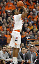 Syracuse's Kris Joseph scores against Connecticut during the first half of an NCAA college basketball game in Syracuse, N.Y., Saturday, Feb. 11, 2012. (AP Photo/KevinRivoli)