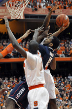 Connecticut's Andre Drummond tries to score between Syracuse defenders during the first half of an NCAA college basketball game in Syracuse, N.Y., Saturday, Feb. 11, 2012. (AP Photo/KevinRivoli)
