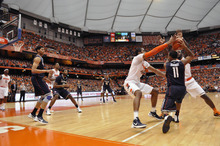 Connecticut's Ryan Boatright, right, is pressured by Syracuse's Dion Waiters and James Southerland during the first half of an NCAA college basketball game in Syracuse, N.Y., Saturday, Feb. 11, 2012. (AP Photo/KevinRivoli)