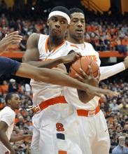 Syracuse's C.J. Fair grabs a rebound against Connecticut during the first half of an NCAA college basketball game in Syracuse, N.Y., Saturday, Feb. 11, 2012. (AP Photo/KevinRivoli)