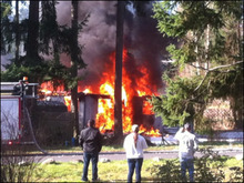 Flames pour from the home of Josh Powell after the Sunday afternoon explosion. Josh Starkey photo via KOMO News