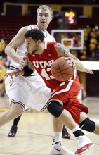 Utah's Cedric Martin, front, drives to the basket past Arizona State forward Jonathan Gilling, rear, during the first half of an NCAA college basketball game Thursday, Feb. 9, 2012, in Tempe, Ariz. (AP Photo/Paul Connors)