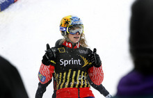 Scott Sommerdorf  |  The Salt Lake Tribune              Women's Snowboardcross winner Dominique Maltais celebrates her win in the Women's Snowboardcross at the U.S. Grand Prix held The Canyons, Sunday February 12, 2012.