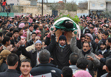 In this Tuesday Feb. 7, 2012 photo, anti-Syrian regime protesters carry the body of a man, who witnesses say was killed by Syrian government forces shelling, during a funeral procession in the Rastan neighborhood of Homs province, central Syria. (AP Photo)