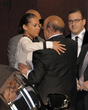Alicia Keys, left, hugs Clive Davis at the loading dock outside the Beverly Hilton Hotel Saturday Feb. 11, 2012 in Beverly Hills, Calif. Whitney Houston, who ruled as pop music's queen until her majestic voice and regal image were ravaged by drug use, erratic behavior and a tumultuous marriage to singer Bobby Brown, died Saturday. She was 48.(AP Photo/Mark J. Terrill)