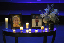 Photos of Charlie, right, and Braden Powell are displayed during their funeral service Saturday, Feb. 11, 2012, in Tacoma, Wash. The boys died Feb. 5, 2012, when their father, Josh Powell, set fire to the home he was living in while they visited. Powell had been a person of interest in the 2009 disappearance of his wife Susan. (AP Photo/The News Tribune, Lui Kit Wong, Pool)