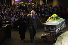 Ted S. Warren  |  The Associated Press Chuck Cox reaches out to touch the casket bearing his grandsons, Charlie and Braden, as he walks with his wife, Judy, during a funeral service Saturday in Tacoma, Wash. The boys died Feb. 5, 2012, when their father, Josh Powell, set fire to the home he was living in while they visited.