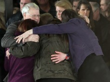 Rick Egan  | The Salt Lake Tribune  Chuck Cox and other family members join in a group hug after the funeral for Charlie and Braden Powell at the Life Center Church in Tacoma.