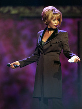 In this photo provided by the Las Vegas News Bureau, Whitney Houston performs during the Billboard Awards at the MGM Grand in Las Vegas on Dec. 7, 1998.  Often referred to as the Queen of Pop music at her best, Houston ex-wife of singer Bobby Brown, died Saturday, Feb. 11, 2012 at the age of 48.  (AP Photo/Las Vegas News Bureau)