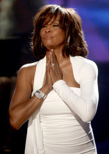 Matt Sayles  |  AP file photo Singer Whitney Houston receives the International Artist Award onstage at the 37th Annual  American Music Awards in Los Angeles Nov. 22, 2009. Houston, who reigned as pop music's queen until her majestic voice and regal image were ravaged by drug use, has died.