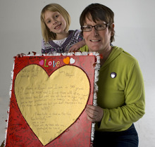Al Hartmann     The Salt Lake Tribune Abigail Hasting-Tharp and her mother Jamila Tharp hold Abigail's valentine to the state of Utah encouraging people to recognize her mothers' rights as a married couple.