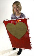 Al Hartmann     The Salt Lake Tribune Abigail Hasting-Tharp holds her valentine to the state of Utah encouraging people to recognize her mothers' rights as a married couple.