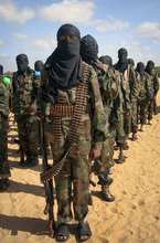 Armed members of the militant group al-Shabab attend a rally on the outskirts of Mogadishu, Somalia Monday, Feb. 13, 2012. Thousands of Somalis gathered at a militant-organized demonstration on the outskirts of Mogadishu on Monday in support of the merger of the Somali militant group al-Shabab with al-Qaida, which was announced last week by al-Qaida leader Ayman al-Zawahri. (AP Photo)