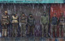Indian policemen take shelter from snow in Srinagar, India, Monday, Feb. 13, 2012. The Jammu-Srinagar highway has been blocked because of heavy snowfall in the region, according to news reports. (AP Photo/Dar Yasin)