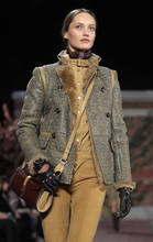 The Tommy Hilfiger Fall 2012 collection is modeled during Fashion Week in New York, Sunday, Feb. 12, 2012.  (AP Photo/Kathy Willens)