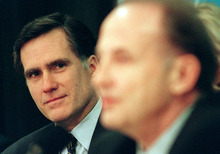 Steve Griffin  |  Tribune file photo Mitt Romney listens as he is being introduced as the Salt Lake Organizing Committee's new president by board chairman Bob Garff on Feb. 10, 1999, at the Hilton Hotel.