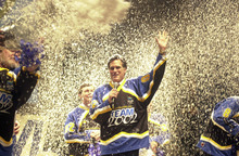 Tribune file photo Mitt Romney waves after being blasted with fake snow at the kickoff of a SLOC volunteer drive in March 2000. The event at Abravanel Hall featured ski racer Picabo Street, former NFL quarterback and volunteer leader Steve Young and Utah Gov. Mike Leavitt.