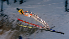 Grayson West | Tribune file photo Russia's Alexander Belov soars through the air during the qualifying round for the large-hill ski jumping competition at the Utah Olympic Park.