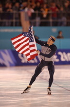 Danny La | Tribune file photo Speedskater Casey Fitzrandolph of the United States skates a victory lap with the American flag after winning the men's 500 meters at the Utah Olympic Oval.