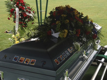 Melinda Rogers | The Salt Lake Tribune Stickers adorn the casket of Charlie and Braden Powell, buried Monday in Washington.