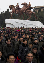 North Koreans leave the grounds of the Mansudae Art Studio in Pyongyang after watching the unveiling of a new bronze statue depicting the late leader Kim Jong Il and his father Kim Il Sung on Tuesday, Feb. 14, 2012. As North Koreans prepare for what would have been the 70th birthday of late leader Kim Jong Il this week, the country's state media have gone to great lengths to build up the man who led the nation for 17 years until his death in December. (AP Photo/David Guttenfelder)