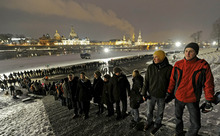 People stand along side each other to form a human chain on the 67th anniversary of the Allied bombing of Dresden during WWII in Dresden, Germany, Monday, Feb. 13, 2012. British and U.S. bombers on Feb. 13-14, 1945 destroyed Dresden's centuries-old baroque city center. The chain was formed to protest against neo-nazis who use the memorial day to spread their ideology by demonstrations in  Dresden.  (AP Photo/Jens Meyer)
