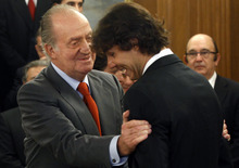 Spanish King Juan Carlos, left, greets Spanish player Rafael Nadal, right, during a meeting at Zarzuela Palace in Madrid, Spain, Tuesday Feb. 14, 2012. The Davis cup team visited the Royal Palace on Tuesday to meet Spain's King Juan Carlos after visiting the Moncloa Palace. (AP Photo/Susana Vera, Pool)