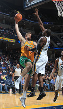 Memphis Grizzlies center Marc Gasol, of Spain, left, shoots by Utah Jazz forward Paul Millsap, right, in the second half of an NBA basketball game on Sunday, Feb. 12, 2012, in Memphis, Tenn.  The Jazz defeated the Grizzlies 98-88. (AP Photo/Nikki Boertman)